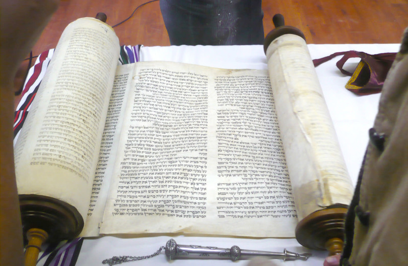 'HAVING CHOSEN God, the Torah is God's response to us.' Pictured: The Yanov Torah, rescued from the Holocaust. (photo credit: Wikimedia Commons)