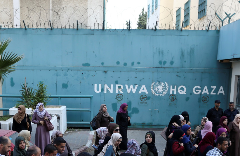 Palestinian employees of United Nations Relief and Works Agency (UNRWA) take part in a protest against job cuts by UNRWA, in Gaza City September 19, 2018.  (photo credit: REUTERS/IBRAHEEM ABU MUSTAFA)
