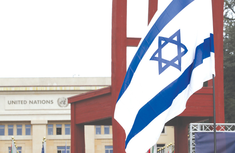 AN ISRAELI FLAG is pictured outside a session of the Human Rights Council at the United Nations in Geneva earlier this year (photo credit: DENIS BALIBOUSE/REUTERS)
