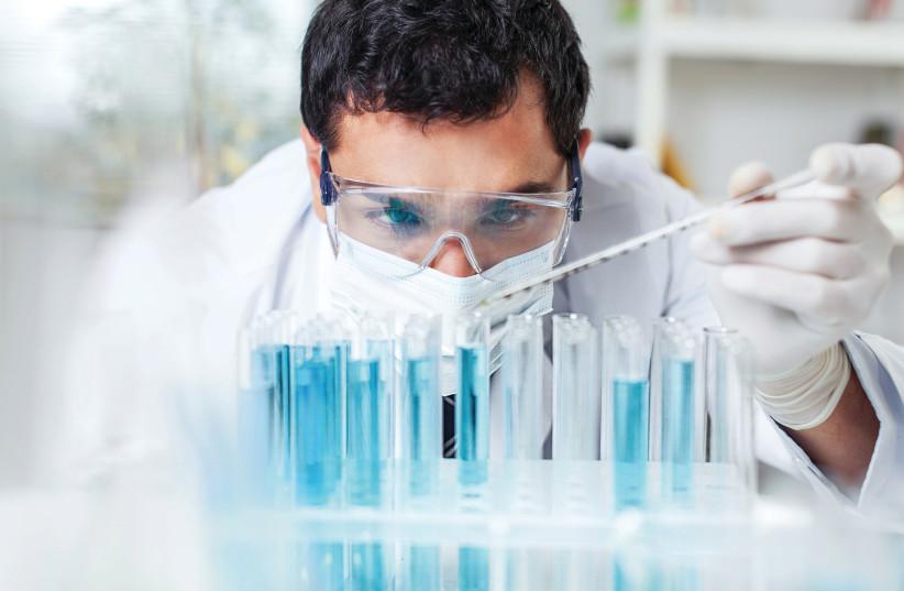 Scientist preforming a test (photo credit: Courtesy)