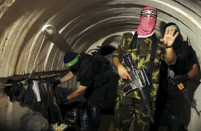 A HAMAS member in a tunnel during the 2014 war (photo credit: REUTERS)