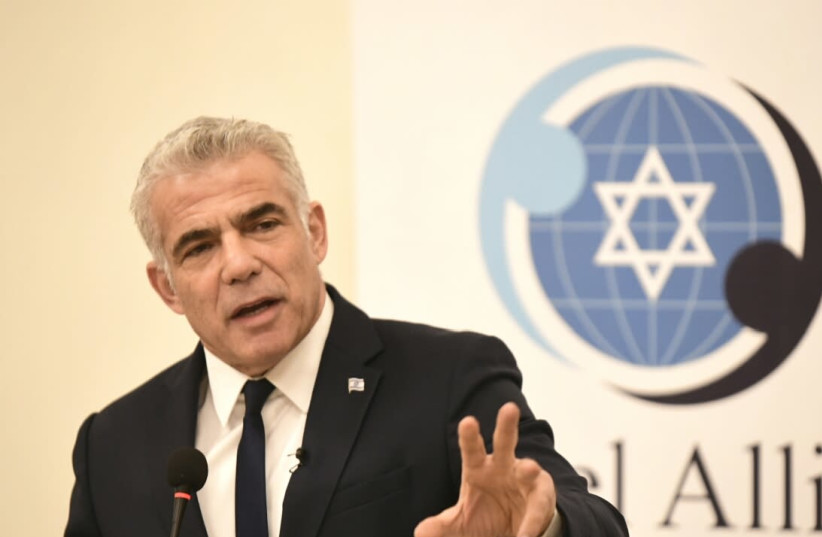 Blue and White No.2, Yair Lapid, speaks at the Israel Allies Foundation conference, December 9, 2019 (photo credit: AVI HAYUN)