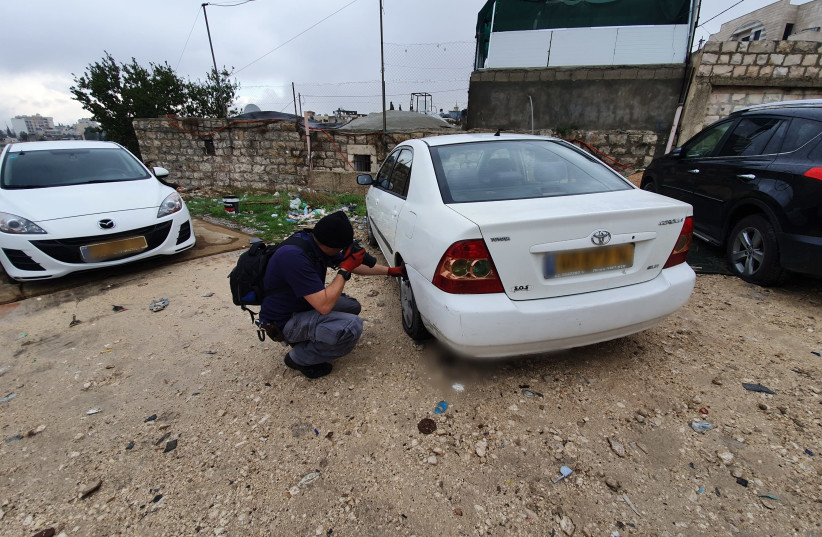 Police investigate suspected price tag attack in Jerusalem's Shu'afat neighborhood on December 9, 2019 (photo credit: ISRAEL POLICE)