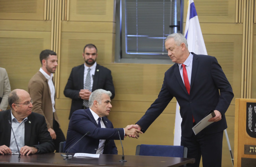 Blue and White leader Benny Gantz shakes hands with Blue and White MK Yair Lapid (photo credit: MARC ISRAEL SELLEM/THE JERUSALEM POST)