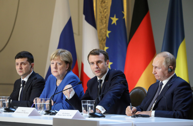 Ukrainian President Volodymyr Zelenskiy, German Chancellor Angela Merkel, French President Emmanuel Macron and Russian President Vladimir Putin give a press conference after a summit on Ukraine at the Elysee Palace in Paris, December 9, 2019 (photo credit: LUDOVIC MARIN/POOL VIA REUTERS)