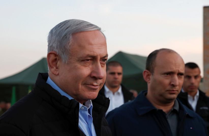 Prime Minister Benjamin Netanyahu and Defense Minister Naftali Bennett visit an army base on the Golan Heights on November 24 (photo credit: REUTERS)