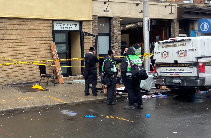 A picture of the scene the day after an hours-long gun battle with two men around a kosher market in Jersey City, NJ, Dec. 11, 2019 (photo credit: REUTERS/LLOYD MITCHELL)