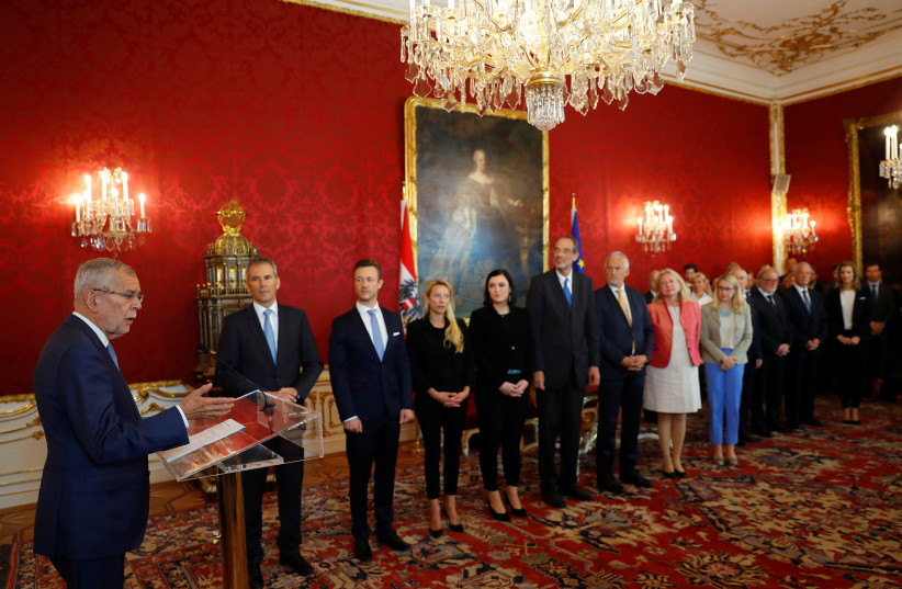 Austrian President Alexander Van der Bellen swears in Austria's provisional government after a no-confidence vote by the Parliament in Vienna, Austria (photo credit: REUTERS/LEONHARD FOEGER)