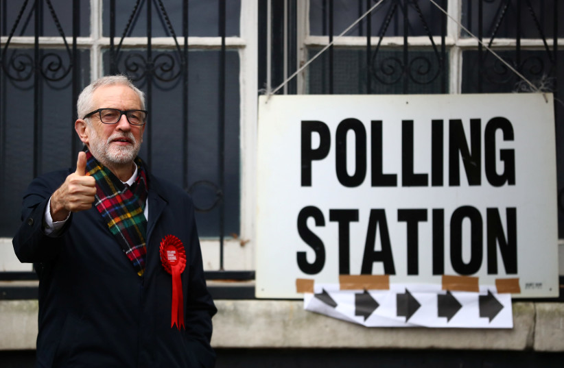 Britain's opposition Labour Party leader Jeremy Corbyn poses outside a polling station after voting in the general election in London, Britain, December 12, 2019 (photo credit: REUTERS/HANNAH MCKAY)