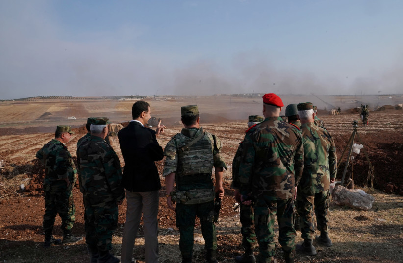 Syrian President Bashar al Assad visits Syrian army troops in war-torn northwestern Idlib province, Syria, October 22, 2019 (photo credit: SANA/HANDOUT VIA REUTERS)