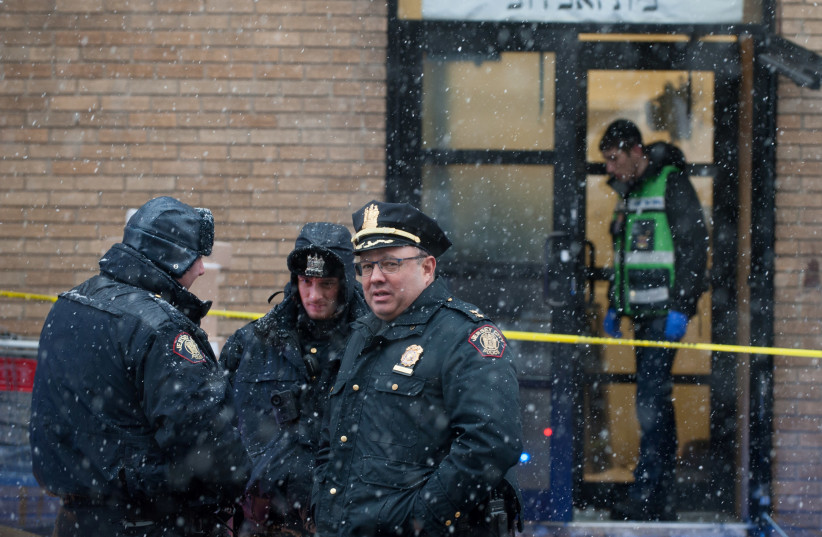 Emergency personnel and investigators work at the scene the day after an hours-long gun battle with two men around a kosher market in Jersey City, New Jersey, U.S., December 11, 2019. (photo credit: REUTERS/LLOYD MITCHELL)