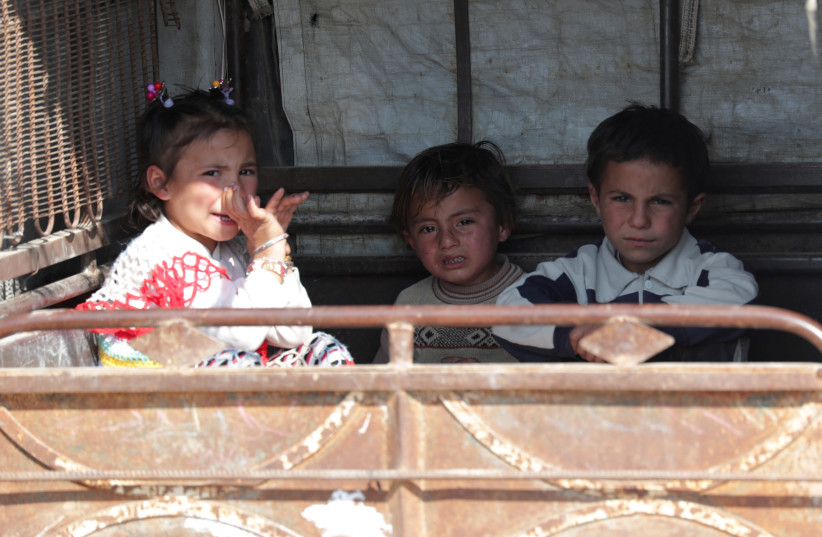 Children sit in an auto rickshaw in Tal Abyad, one of the cities in which Turkish President Tayyip Erdogan plans to resettle Syrian refugees (photo credit: KHALIL ASHAWI / REUTERS)