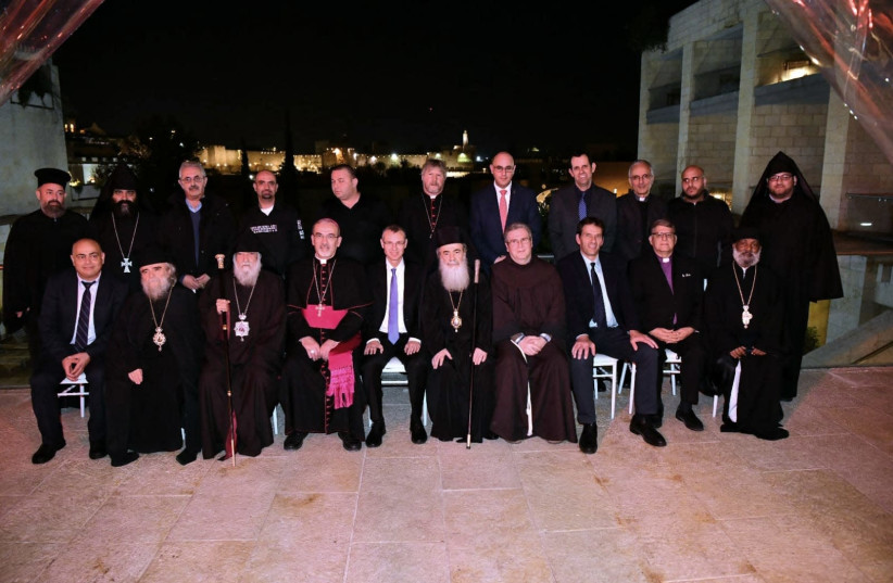 Clergymen meet with Tourism Minister Yariv Levin at the Holy Sepulchre Church (photo credit: SHLOMI AMSALEM)