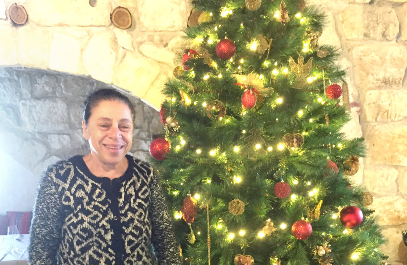 CHRISTMAS TREE, my Christmas tree: Salma Assaf in her restaurant, Chateau de Roi (photo credit: DIANA BLETTER)