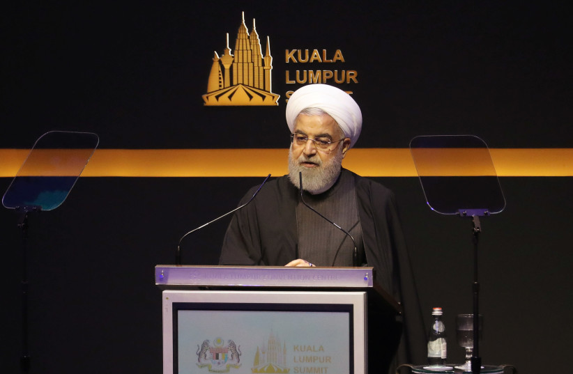 Iranian President Hassan Rouhani speaks during Kuala Lumpur Summit in Malaysia (photo credit: REUTERS/LIM HUEY TENG)
