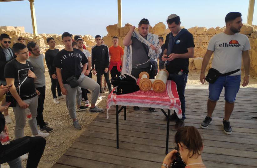 A group of French Jewish students visiting Israel with Israel Experience pray on top of Masada. (photo credit: Courtesy)
