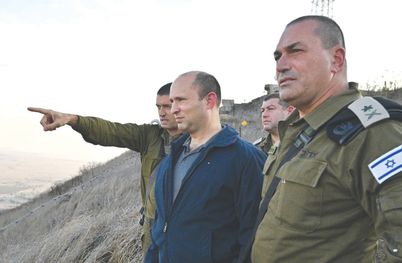 Defense Minister Naftali Bennett during a recent visit to the Syrian border (photo credit: ARIEL HERMONI / DEFENSE MINISTRY)