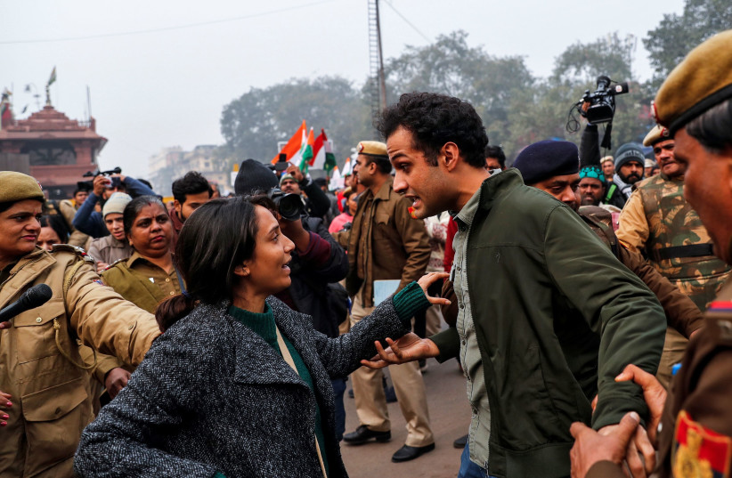 Demonstrators are detained during a protest against a new citizenship law, in Delhi, India, December 19, 2019 (photo credit: DANISH SIDDIQUI/ REUTERS)