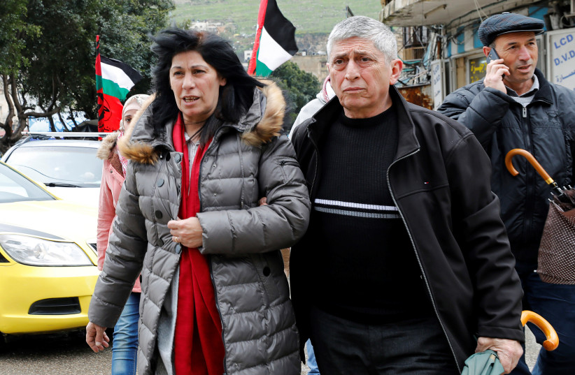 Khalida Jarrar, a senior Popular Front for the Liberation of Palestine's (PFLP) political figure, walks with people after she was released from an Israeli jail, in Nablus, in the Israeli-occupied West Bank February 28, 2019 (photo credit: ABED OMAR QUSINI/REUTERS)
