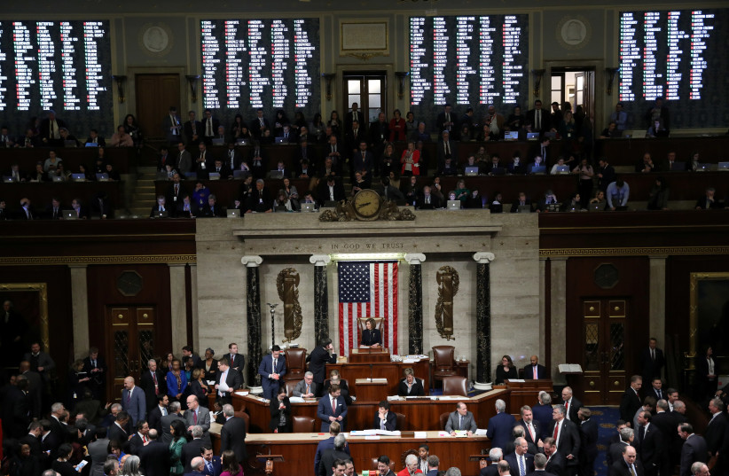 U.S. House of Representatives votes on Trump impeachment on Capitol Hill in Washington on December 19, 2019. (photo credit: REUTERS/JONATHAN ERNST)