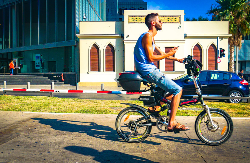 Electric bicycles are a newish phenomenon in Israel, with some controversy around increasing fatalities and accidents, and competition with the bikesharing network. (photo credit: TED EYTAN)