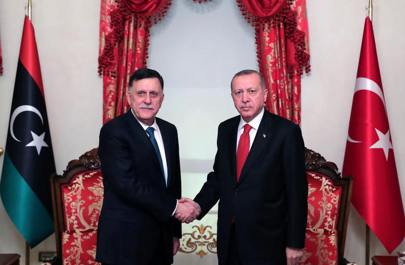Turkish President Tayyip Erdogan meets with Libya's internationally recognised Prime Minister Fayez al-Sarraj in Istanbul, Turkey, November 27, 2019. Picture taken November 27, 2019 (photo credit: PRESIDENTIAL PRESS OFFICE/HANDOUT VIA REUTERS)