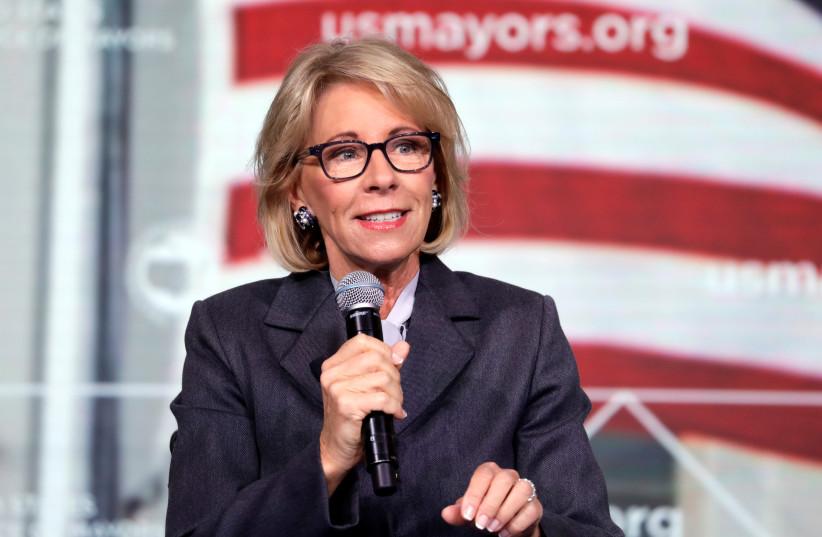 US Education Secretary Betsy DeVos speaks at a Conference in Washington.  (photo credit: YURI GRIPAS/REUTERS)