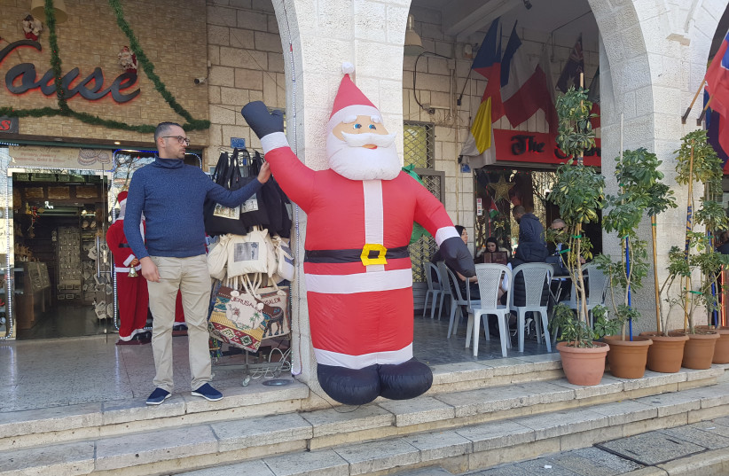 Store owners in Bethlehem (photo credit: KHALED ABU-TOAMEH)
