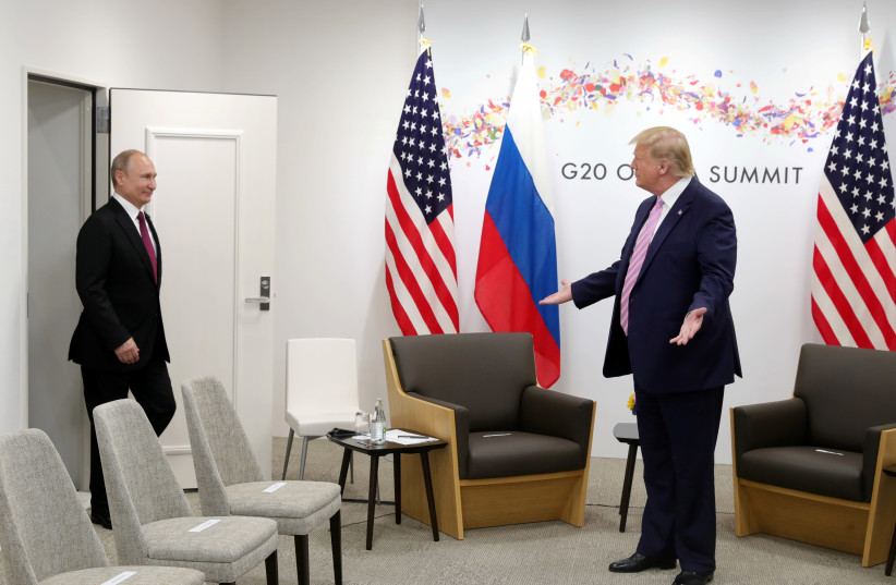 Russian President Vladimir Putin and US President Donald Trump at the G20 summit in Osaka, Japan June 28, 2019 (photo credit: SPUTNIK/MIKHAIL KLIMENTYEV/KREMLIN VIA REUTERS)