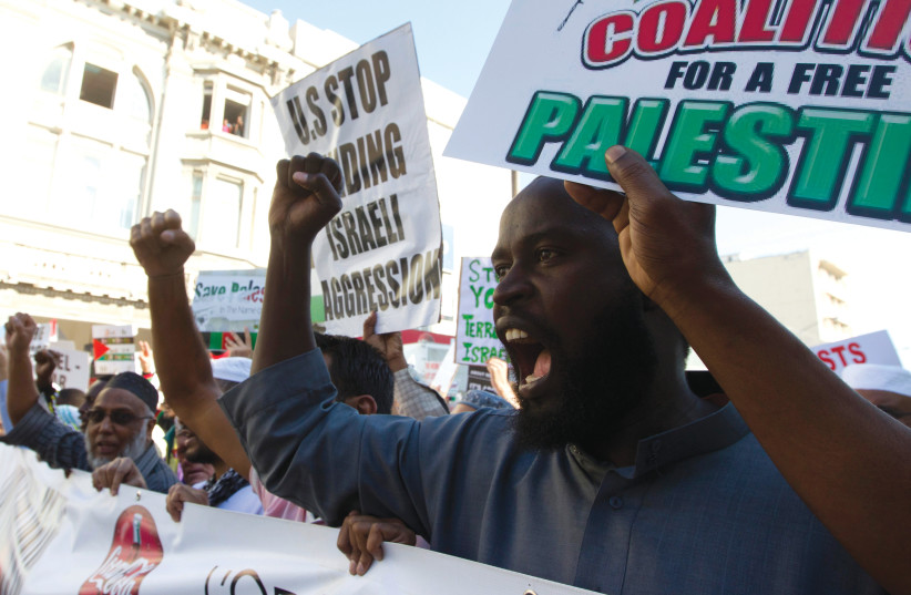 ANTI-ISRAEL PROTESTERS emerge after Friday Islamic prayers in Durban, South Africa in 2014.  (photo credit: REUTERS)