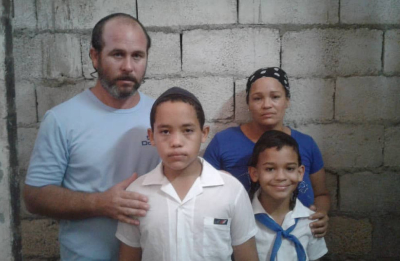 Parents Olainis Tejada Beltrán and Yeliney Lescaille Prebal with their two children (photo credit: Courtesy)