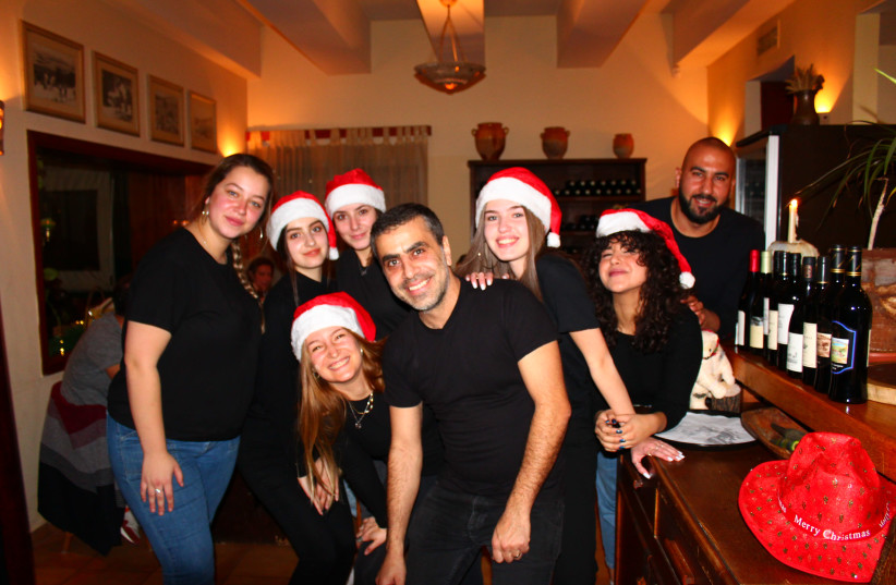 Aluma Gallilean Bistro owner Alaa Sweitat spreads holiday cheer at his annual Christmas Dinner in Tarshiha (photo credit: WESTERN GALILEE NOW)