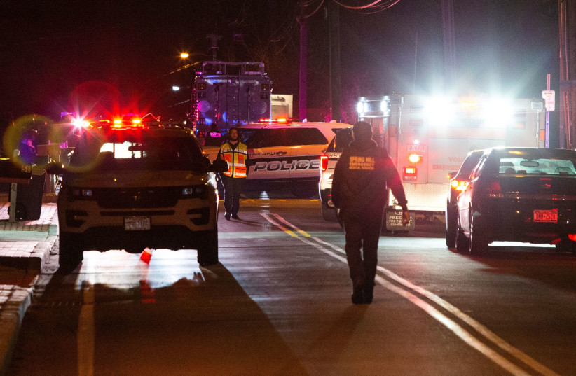 First responders walk the area where 5 people were stabbed at a Hasidic rabbi's home in Monsey, New York (photo credit: EDUARDO MUNOZ / REUTERS)