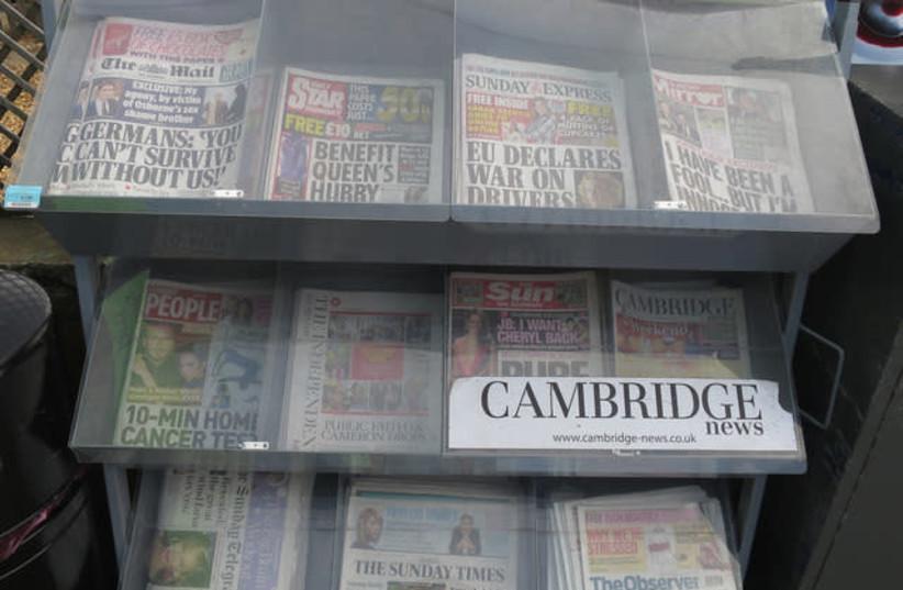 A newspaper rack in the United Kingdom (photo credit: REUTERS)