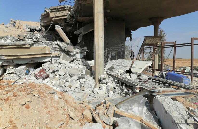 Destroyed headquarters of Kataib Hezbollah militia group are seen after in an air strike in Qaim, Iraq, December 30, 2019 (photo credit: REUTERS/STRINGER)