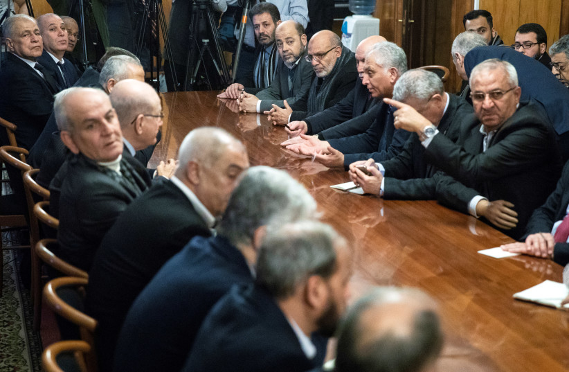 Fatah and Hamas officials wait for a meeting with Russian Foreign Minister Sergei Lavrov and representatives of Palestinian groups and movements as a part of an intra-Palestinian talks in Moscow, Russia February 12, 2019 (photo credit: PAVEL GOLOVKIN/POOL VIA REUTERS)