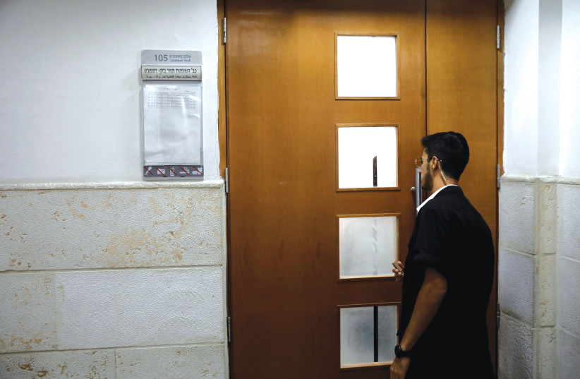 A SECURITY GUARD at a courthouse in Jerusalem. (photo credit: REUTERS)