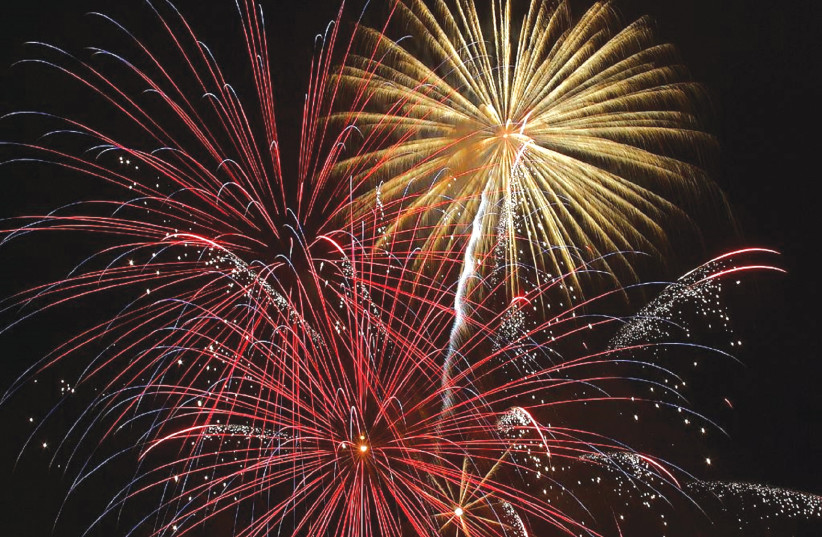 WELCOMING THE new year.  (photo credit: Wikimedia Commons)