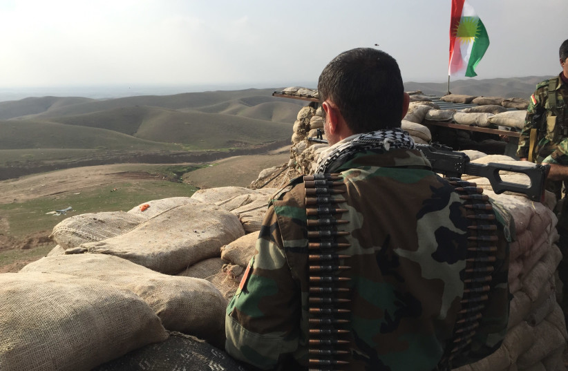 A Kurdistan Region Peshmerga looks out at ISIS positions from his frontline near Kirkuk in 2015 (photo credit: SETH J. FRANTZMAN)
