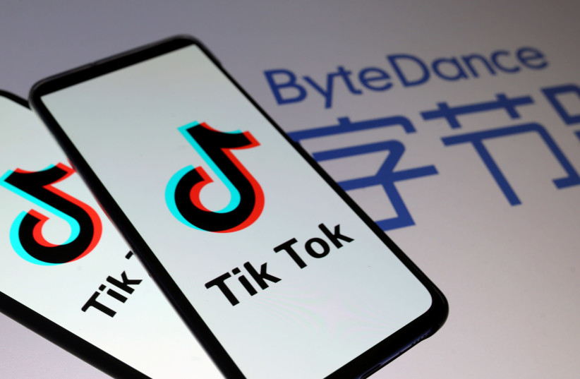 Tik Tok logos are seen on smartphones in front of displayed ByteDance logo in this illustration (photo credit: REUTERS)
