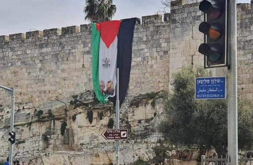 PLO flag hoisted over Jerusalem's Old City walls near the Damascus Gate, Jan. 1, 2020 (photo credit: MAOR TZEMACH/LACH JERUSALEM)