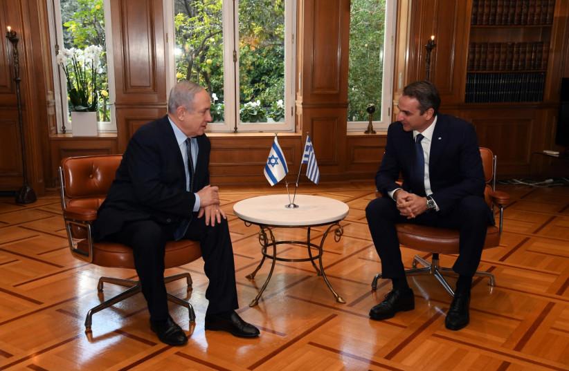 Prime Minister Benjamin Netanyahu [L] with Greek Prime Minister Kyriakos Mitsotakis [R].   (photo credit: HAIM ZACH/GPO)