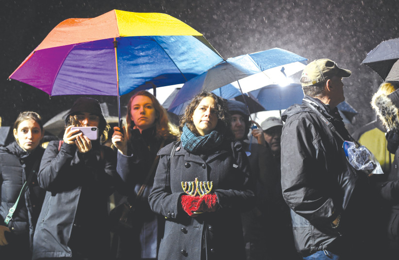 People gather at Grand Army Plaza in solidarity with the victims of the attack in Monsey. (photo credit: AMR ALFIKY/ REUTERS)