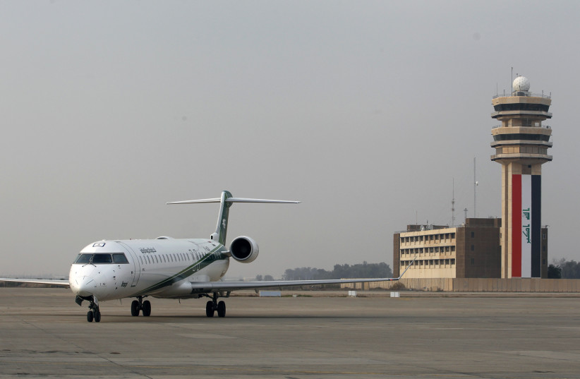 An Iraqi Airways plane lands at Baghdad International airport (photo credit: REUTERS/THAIER AL-SUDANI)