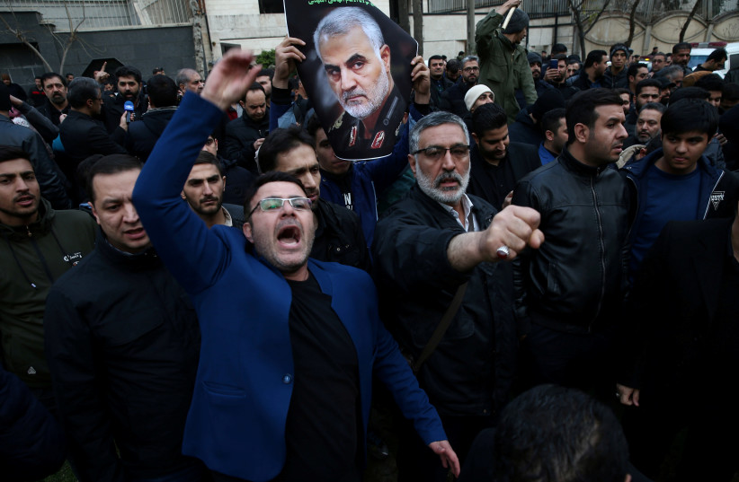 FILE PHOTO: Iranian demonstrators react during a protest against the killing of the Iranian Major-General Qassem Soleimani, head of the elite Quds Force, and Iraqi militia commander Abu Mahdi al-Muhandis, who were killed in an air strike at Baghdad airport, in front of United Nations office in Tehra (photo credit: NAZANIN TABATABAEE/WANA (WEST ASIA NEWS AGENCY) VIA REUTERS)