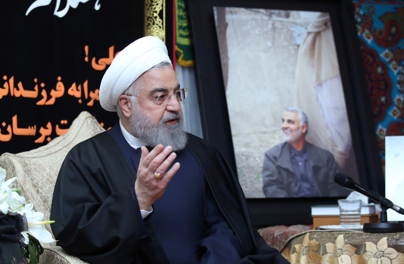 Iranian President Hassan Rouhani visits the family of the Iranian Major-General Qassem Soleimani, head of the elite Quds Force, who was killed by an air strike in Baghdad, at his home in Tehran, Iran January 4, 2020 (photo credit: OFFICIAL PRESIDENT WEBSITE/HANDOUT VIA REUTERS)