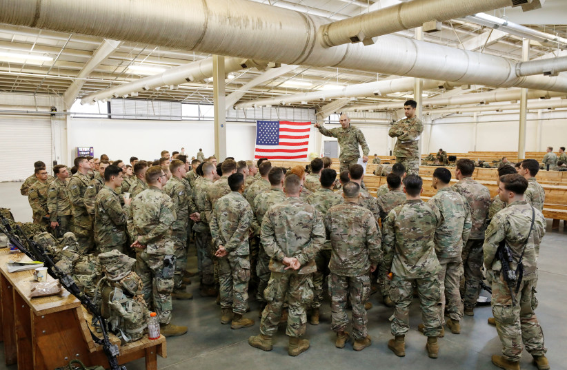 U.S. Army paratroopers from the 2nd Battalion, 504th Parachute Infantry Regiment, 1st Brigade Combat Team, 82nd Airborne Division, prepare for departure for the Middle East from Fort Bragg, North Carolina, U.S. January 4, 2020. (photo credit: JONATHAN DRAKE / REUTERS)