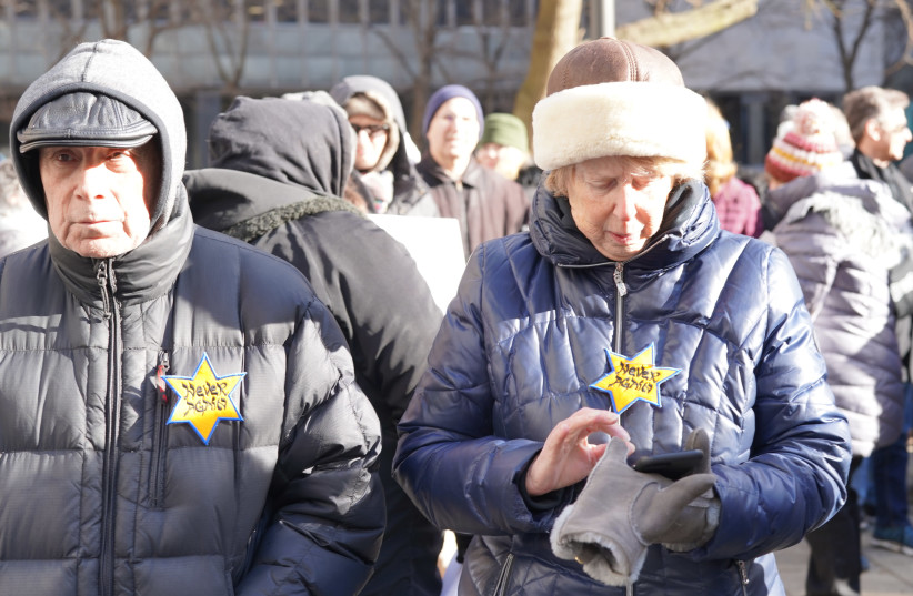 People attend a march in New York against antisemitism wearing yellow stars which read never again, January 5, 2020.  (photo credit: JFNA)