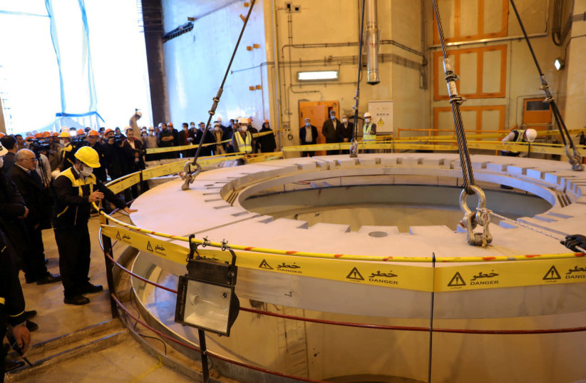 FILE PHOTO: Members of the media and officials tour the water nuclear reactor at Arak, Iran December 23, 2019. WANA (West Asia News Agency) via REUTERS  (photo credit: REUTERS)