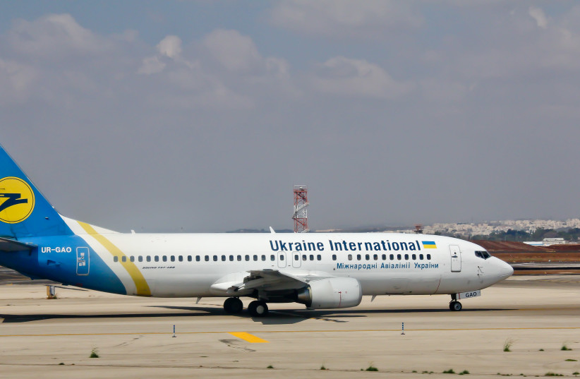 A Ukraine International Airlines Boeing 737-400 at Ben Gurion Airport, illustrative (photo credit: RAIMOND SPEKKING/WIKIMEDIA COMMONS)